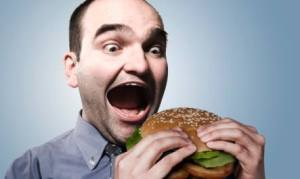 guy-eating-bi-hamburger-with-bun-2